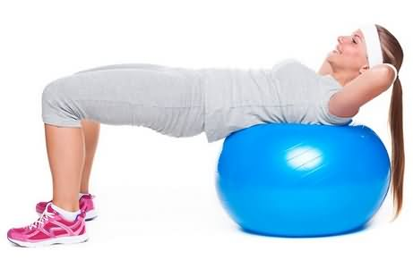 Woman doing exercise on ball for abs